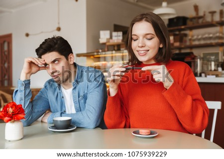Beautiful brunette woman taking pleasure while enjoying landmark Stock photo © deandrobot