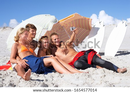 Quatre plage fille femmes Photo stock © Massonforstock