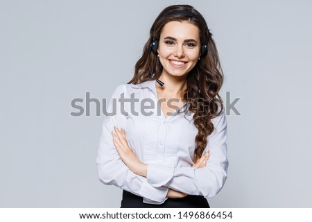 Photo of happy young woman in white shirt and black skirt pointi Stock photo © deandrobot