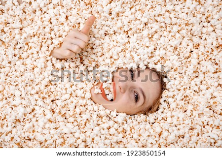 Image of beautiful european woman 20s eating popcorn from bucket Stock photo © deandrobot