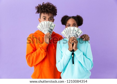 Photo of successful african american couple in colorful clothes  Stock photo © deandrobot