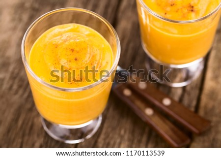Homemade pumpkin mousse or cream in glasses sprinkled with cinna Stock photo © boggy