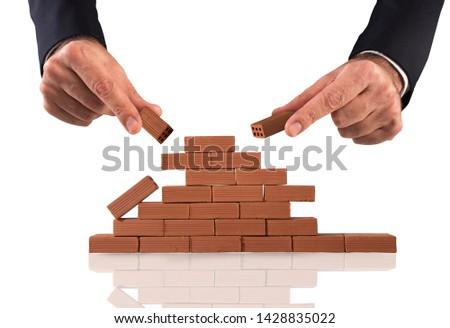 zakenman · baksteen · bouwen · muur · nieuwe · business - stockfoto © alphaspirit