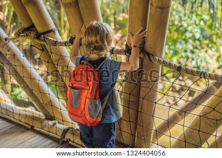 Boy in Bamboo village, Traditional houses constructed by Bamboo  Stock photo © galitskaya