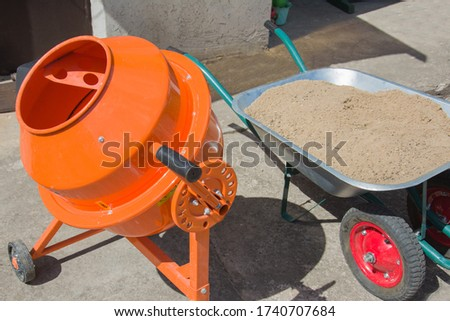 Construction Workers Pouring And Leveling Wet Cement Into Wood F Stock photo © feverpitch