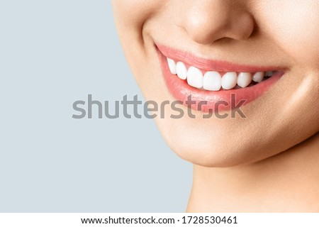 Close-up happy female smile with healthy white teeth, lips makeup. Cosmetology, dentistry and beauty Stock photo © serdechny