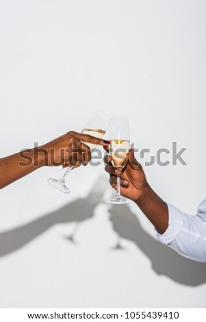 Woman hand holding glasses of champagne on the black background Stock photo © Freedomz