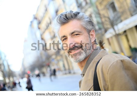 Handsome mature man in town Stock photo © Lopolo