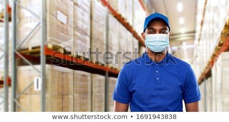 Feliz indio mensajero azul uniforme mail Foto stock © dolgachov