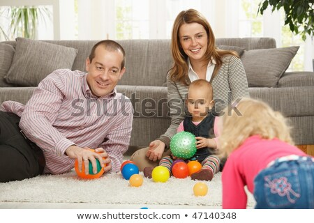 Happy nuclear family playing together at home stock photo © nyul