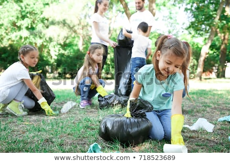 Man Collecting Garbage in Park, Environment Care Stock photo © robuart