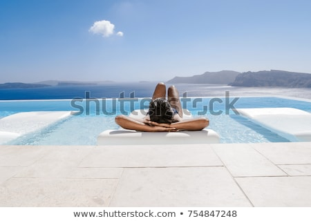 happy woman over swimming pool of touristic resort Stock photo © dolgachov