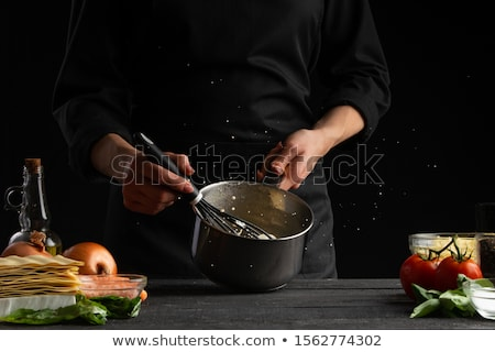 Stock photo: Chef stirring pasta