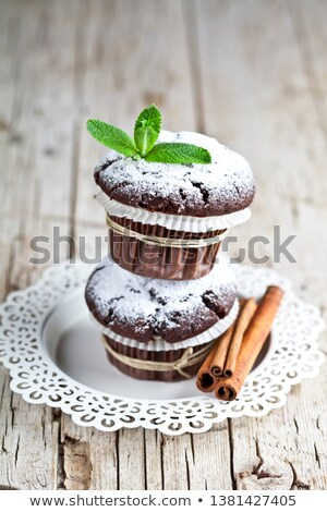 Chocolate dark muffins with sugar powder and mint leaf on rustic Stock photo © marylooo