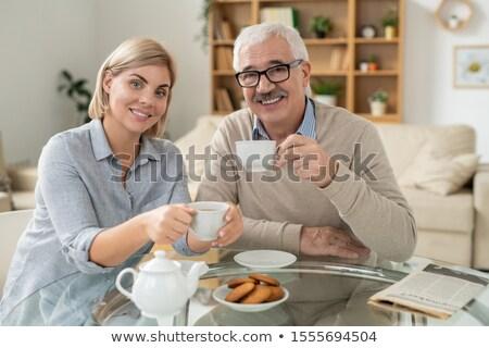 Boldog fiatal nő nyugdíjas apa tart csészék Stock fotó © pressmaster