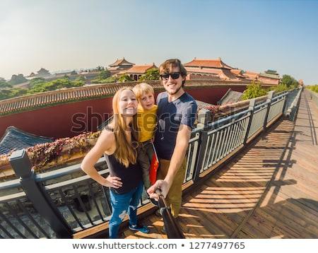 отпуск Китай молодым человеком китайский флаг Сток-фото © galitskaya