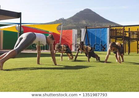 Vue entraîneur enseignement yoga Photo stock © wavebreak_media