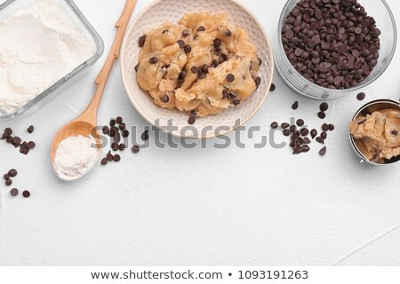 White chocolate biscuit cookies on light kitchen table background. Stock photo © DenisMArt