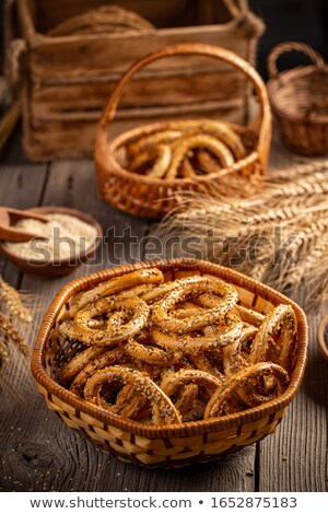 Pretzels ring in rustic basket Stock photo © grafvision