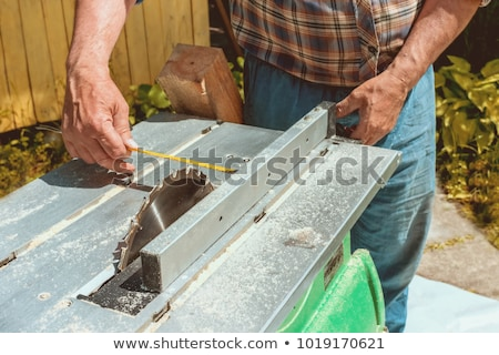 The worker makes measurements of a wooden board Stock photo © olira