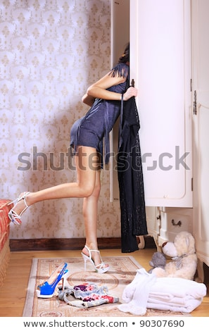 woman near sliding-door wardrobe Stock photo © ssuaphoto