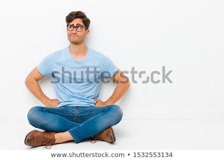 élégant jeune homme séance pense blanche triste Photo stock © Rebirth3d