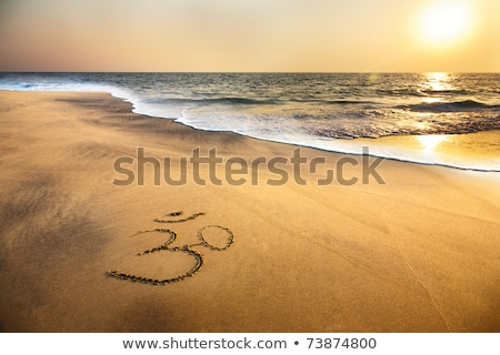 Aum / om by sunset Stock photo © Elenarts