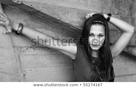 Greyscale Portrait of the girl by the concrete wall Stock photo © pekour
