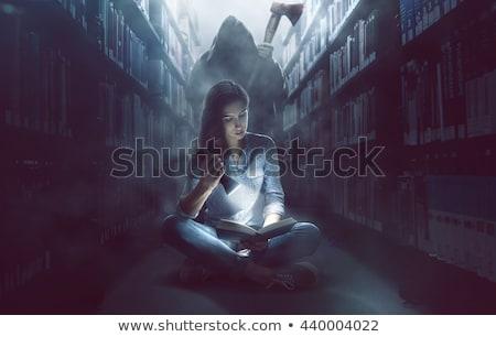 woman reading a thriller book Stock photo © feedough