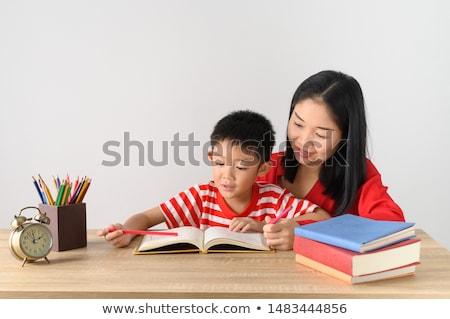 öğrenci · ödev · ev · kız · gülümseme - stok fotoğraf © williv