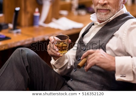 Foto stock: Senior Businessman Smoking Cigar