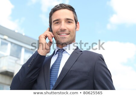 Estate-agent stood with client outside house Stock photo © photography33