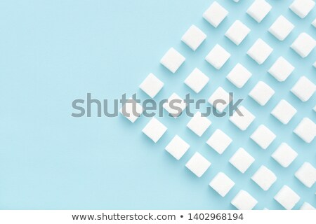 Stock photo: Sugar cubes on white background.