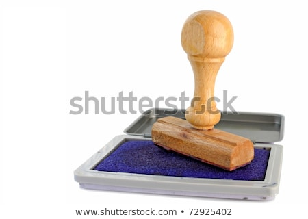 closeup rubber stamp with stamp pad on white background stock photo © inxti