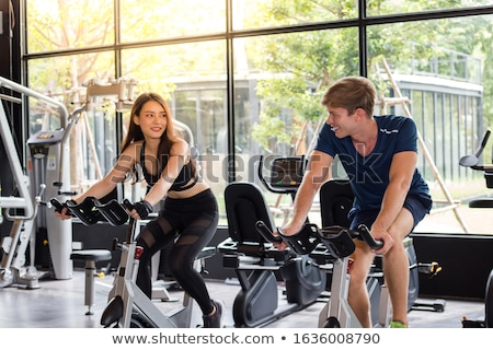 Couple cycle machine sport Photo stock © photography33
