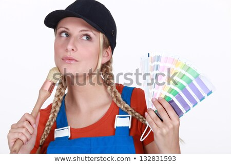 blonde painter looking inspired holding color chart and brush Stock photo © photography33
