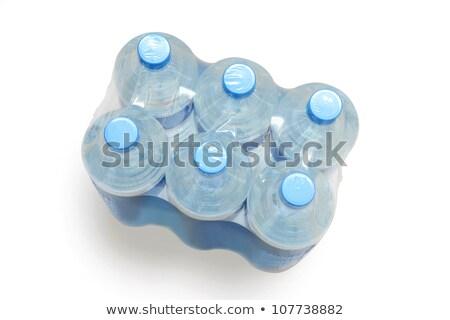 Seis empacotar água mineral fundo azul fábrica Foto stock © photography33