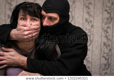 Terrorist portret gijzelaar achteraanzicht jonge man Stockfoto © tiero
