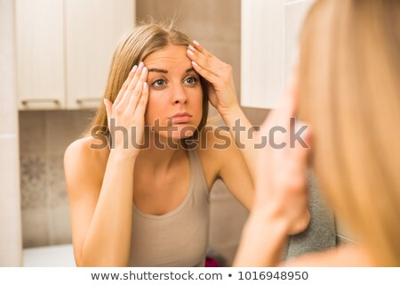 Stock photo: Angry young woman wrinkled face