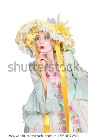 Theatrical woman dressed in a large bonnet and flouncy dress Stock photo © photography33