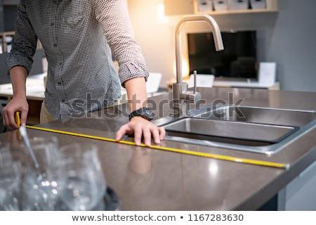 installing kitchen counter   measuring stock photo © lisafx