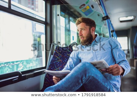 serious seated young man stock photo © feedough
