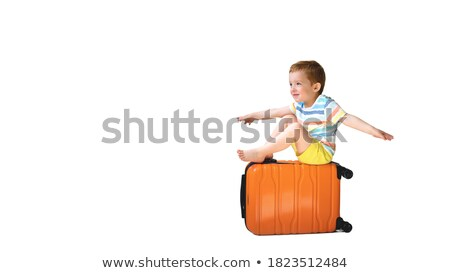 funny picture of little boy in suitcase Stock fotó © konradbak