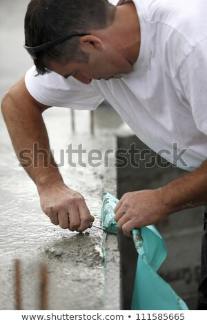Mason removing plastic sheet from wall Stock photo © photography33
