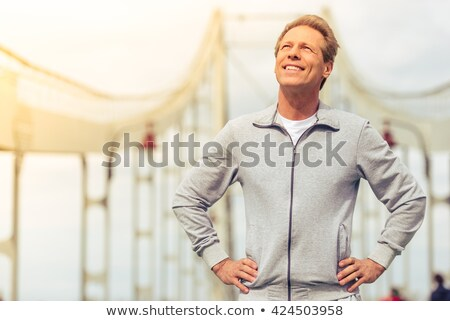 smiling middle aged man looking upwards stock photo © photography33