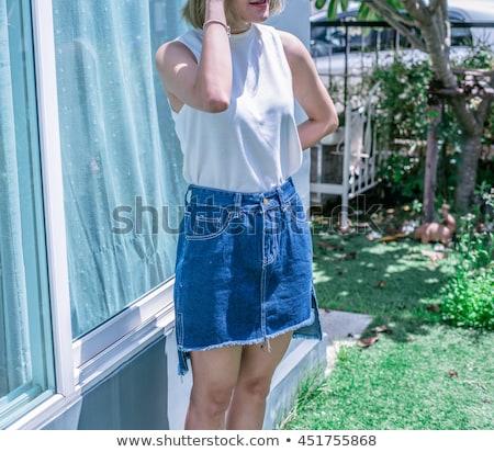 Aantrekkelijk meisje jeans minirok geïsoleerd vrouw Blauw Stockfoto © acidgrey