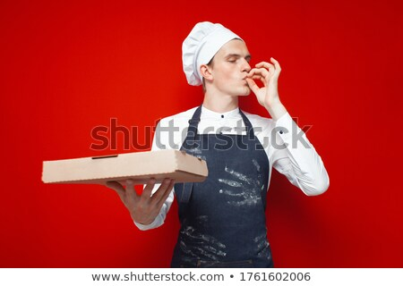 A young pizza maker Stock photo © photography33