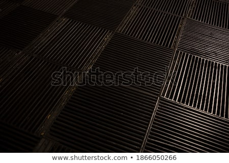 Black metallic background with pits and space for text