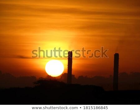 sun set in industrial area stock photo © ziprashantzi