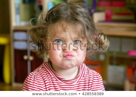 Angry child make a grimace Stock photo © doupix